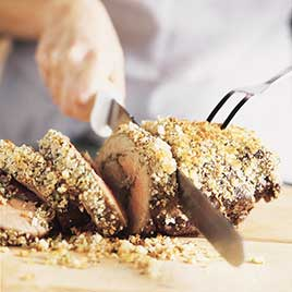 Indian-Spiced Roast Boneless Leg of Lamb with Herbed Almond-Raisin Crust